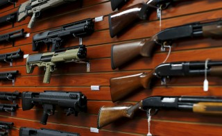 "Shotguns are shown for sale at the AO Sword gun store in El Cajon, California, Jan. 5, 2016. President Barack Obama said on Monday his new executive actions to tighten gun rules were ""well within"" his legal authority and consistent with the U.S. right to bear arms, a warning to opponents who are likely to challenge them in court. Photo by Mike Blake/Reuters"
