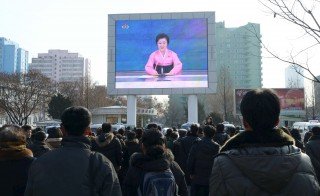 People watch a huge screen broadcasting the government's announcement in Pyongyang, North Korea, in this photo released by Kyodo January 6, 2016. North Korea said it successfully tested a miniaturised hydrogen nuclear bomb on Wednesday, claiming a significant advance in its strike capability and setting off alarm bells in Japan and South Korea. Mandatory credit REUTERS/Kyodo ATTENTION EDITORS - THIS IMAGE HAS BEEN SUPPLIED BY A THIRD PARTY. FOR EDITORIAL USE ONLY. NOT FOR SALE FOR MARKETING OR ADVERTISING CAMPAIGNS. MANDATORY CREDIT. JAPAN OUT. NO COMMERCIAL OR EDITORIAL SALES IN JAPAN. THIS PICTURE IS DISTRIBUTED EXACTLY AS RECEIVED BY REUTERS, AS A SERVICE TO CLIENTS. - RTX21999