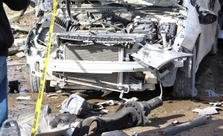A wrecked vehicle is pictured at the scene of an explosion at the Police Training Centre in the town of Zliten, Libya, January 7, 2016. REUTERS/StringerFOR EDITORIAL USE ONLY. NO RESALES. NO ARCHIVE. - RTX21FG5