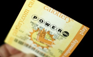 A Powerball lottery ticket is shown in this illustration photograph in Encinitas, California January 8, 2016. The jackpot in the Powerball lottery, already the largest ever payout in North American history, continued to climb, hitting an estimated $800 million on Friday, the operator of the multistate game said. Photo by Mike Blake/Reuters
