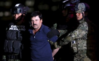 "Joaquin ""El Chapo"" Guzman is escorted by soldiers during a presentation at the hangar belonging to the office of the Attorney General in Mexico City, Mexico Jan. 8, 2016. Photo by Edgard Garrido/Reuters"