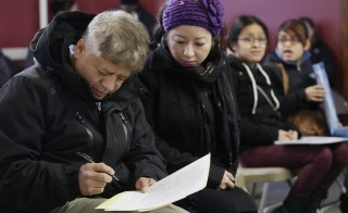 Migrants attend a workshop for legal advice held by the Familia Latina Unida and Centro Sin Fronteras at a church in Chicago, Illinois, Jan. 10, 2016.  Campaigns are going on in cities from Boston to Richmond, California, as activists, legal aid organizations and immigrant groups react to the United States government's recent announcement it would step up deportations of Central Americans families that arrived since May 2014. Photo by Joshua Lott/Reuters
