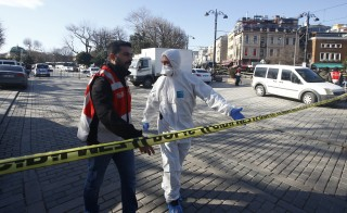 Emergency services attend the scene after an explosion near the Blue Mosque in Istanbul, Turkey on Jan. 12, 2016. Ten people were killed and fifteen others were wounded after a suicide bombing rocked a historic square in Istanbul on Tuesday. Photo by Osman Orsal/Reuters