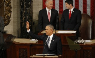 U.S. President Barack Obama waves as he arrives at the podium to deliver his State of the Union address to a joint session of Congress in Washington, January 12, 2016. Photo by Carlos Barria/Reuters