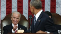 Vice President Joe Biden (L) points to U.S. President Barack Obama while Obama delivered his final State of the Union address to a joint session of Congress in Washington January 12, 2016. REUTERS/Evan Vucci/Pool  - RTX224W9