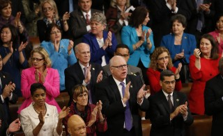 Democratic members of Congress rise and applaud President Barack Obama during his State of the Union address to a joint session of Congress in Washington, January 12, 2016. REUTERS/Jonathan Ernst  - RTX224XU