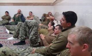 An undated picture released by Iran's Revolutionary Guard website shows American sailors sitting in an unknown place in Iran. Sepahnews.ir/TIMA/Handout via Reuters