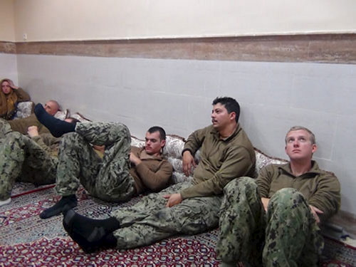 An undated picture released by Iran's Revolutionary Guards website shows American sailors sit in an unknown place in Iran. Handout via Reuters/sepahnews.ir/TIMA