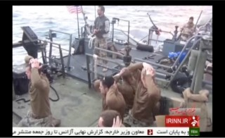 U.S. sailors are pictured on a boat with their hands on their heads at an unknown location in this still image taken from video taken Jan. 12-13, 2016. Photo by Islamic Republic of Iran News Network via Reuters TV