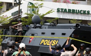 A police armored personnel carrier is seen parked near the scene of an attack in central Jakarta on Jan. 14, 2016. Militants launched a gun and bomb assault in the center of the Indonesian capital on Thursday, leaving seven people, including five gunmen, dead. Photo by Darren Whiteside/Reuters
