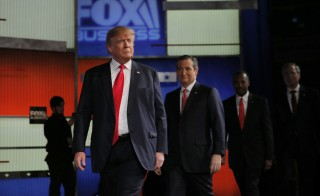 Republican U.S. presidential candidate and businessman Donald Trump (L) arrives onstage with rivals Senator Ted Cruz, Dr. Ben Carson and former Governor Jeb Bush before the start of the Fox Business Network Republican presidential candidates debate in North Charleston, South Carolina Jan. 14, 2016. The Republican establishment has conceded New Hamshire and Iowa, where primaries will start in February. Photo By Chris Keane/Reuters