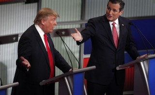Republican U.S. presidential candidate businessman Donald Trump (L) and Senator Ted Cruz speak simultaneously at the Fox Business Network Republican presidential candidates debate in North Charleston, South Carolina, January 14, 2016. REUTERS/Randall Hill  - RTX22GSO