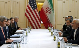 U.S. Secretary of State John Kerry meets with Iranian Foreign Minister Mohammad Javad Zarif in the hours leading up to the annoucement. Photos By Kevin Lamarque/Reuters