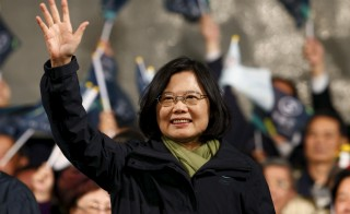 Democratic Progressive Party (DPP) Leader and presidential candidate Tsai Ing-wen waves to her supporters after her election victory at party headquarters in Taipei, Taiwan Jan. 16, 2016. Photos By Pichi Chuang/Reuters