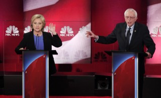 Democratic U.S. presidential candidate and former Secretary of State Hillary Clinton (L) and rival candidate U.S. Senator Bernie Sanders (R) speak simultaneously at the NBC News - YouTube Democratic presidential candidates debate in Charleston, South Carolina January 17, 2016. The two sides have reached a tentative deal to hold an additional debate nest week in New Hampshire, before the nation's first presidential primary, along with other later this year.  Randall Hill/Reuters