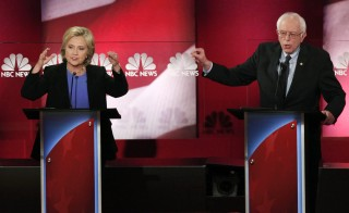 Democratic U.S. presidential candidate and U.S. Senator Bernie Sanders speaks as former Secretary of State Hillary Clinton listens at the NBC News - YouTube Democratic presidential candidates debate in Charleston, South Carolina Jan. 17, 2016. Photo By Randall Hill/Reuters