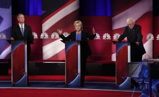 Democratic U.S. presidential candidate and former Secretary of State Hillary Clinton speaks as she discusses issues with former Governor Martin O'Malley (L) and Senator Bernie Sanders at the NBC News - YouTube Democratic presidential candidates debate in Charleston, South Carolina January 17, 2016. REUTERS/Randall Hill  - RTX22TL4