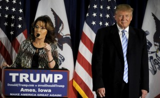 U.S. Republican presidential candidate Donald Trump (R) as former Alaska Gov. Sarah Palin endorses him at a rally at Iowa State University in Ames, Iowa, Jan. 19, 2016. Photo by Mark Kauzlarich/Reuters