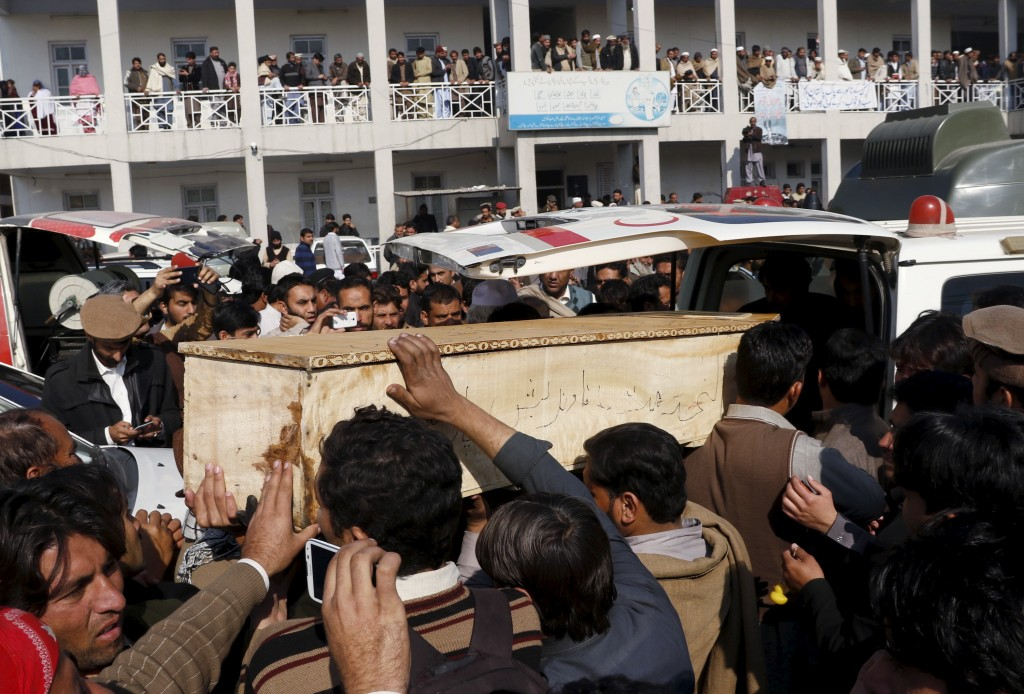 Relatives and friends surround the coffin of a student, who was killed in a militant attack at Bacha Khan University, outside a hospital in Charsadda, Pakistan, on Jan. 20. Photo by Khuram Parvez/Reuters