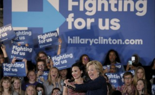 Democratic presidential candidate Hillary Clinton is joined by singer Demi Lovato at a campaign event in Iowa City, Iowa. Photo by Jim Young/Reuters