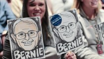 Karen Zwick of Concord holds two caricatures of U.S. Democratic presidential candidate and U.S. Senator Bernie Sanders before his campaign meeting with students at Concord High School in Concord, New Hampshire January 22, 2016.  REUTERS/Katherine Taylor - RTX23LOZ
