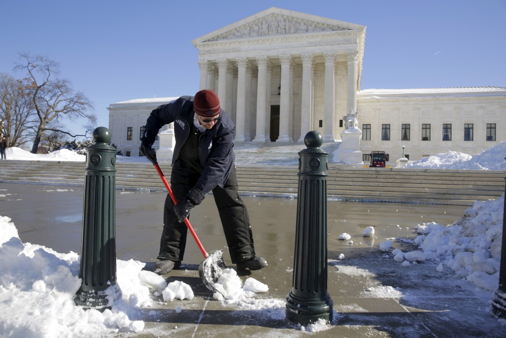 Josh Butcher clears snow from in front of the U.S. Supreme Court after a major winter storm swept over Washington Jan. 24, 2016. The National Weather Service said 17.8 inches fell in Washington, tying as the fourth-largest snowfall in the city's history.   Photos By Joshua Roberts/Reuters