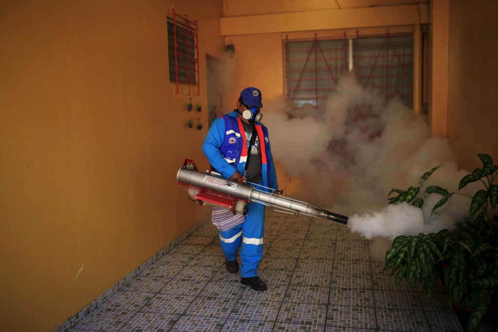 City workers fumigate the Centro America neighborhood of San Salvador, El Salvador, as part of preventive measures against the Zika virus and other mosquito-borne diseases on Jan. 27. Photo by Jose Cabezas/Reuters