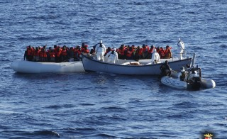 Migrants are rescued by the Italian Navy in the Mediterranean Sea, in this picture released on January 28, 2016 by Italian Navy. Italy's navy rescued 290 migrants and recovered six bodies from the water near a half-sunken rubber boat on Thursday, the first sea deaths recorded on the North Africa to Italy route this year, a spokesman said.  REUTERS/Italian Navy/Handout via ReutersATTENTION EDITORS - THIS PICTURE WAS PROVIDED BY A THIRD PARTY. REUTERS IS UNABLE TO INDEPENDENTLY VERIFY THE AUTHENTICITY, CONTENT, LOCATION OR DATE OF THIS IMAGE. FOR EDITORIAL USE ONLY. NOT FOR SALE FOR MARKETING OR ADVERTISING CAMPAIGNS. THIS PICTURE IS DISTRIBUTED EXACTLY AS RECEIVED BY REUTERS, AS A SERVICE TO CLIENTS. - RTX24F7C