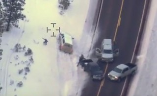 Aerial video released by the FBI January 28, 2016 shows a man who had just stepped out of the white pickup truck at a police roadblock January 26 near Burns, Oregon. The FBI released video showing one of the men occupying an Oregon wildlife refuge reach for his jacket pocket before he was shot dead by law enforcement after speeding away from a traffic stop where the group's leader was arrested.  Authorities said 54-year-old Robert LaVoy Finicum, a rancher from Arizona who acted as a spokesman for the occupiers at the Malheur National Wildlife Refuge, was armed when he was stopped by police and killed on Tuesday afternoon.  REUTERS/FBI/Handout via Reuters  FOR EDITORIAL USE ONLY. NOT FOR SALE FOR MARKETING OR ADVERTISING CAMPAIGNS - RTX24HPQ
