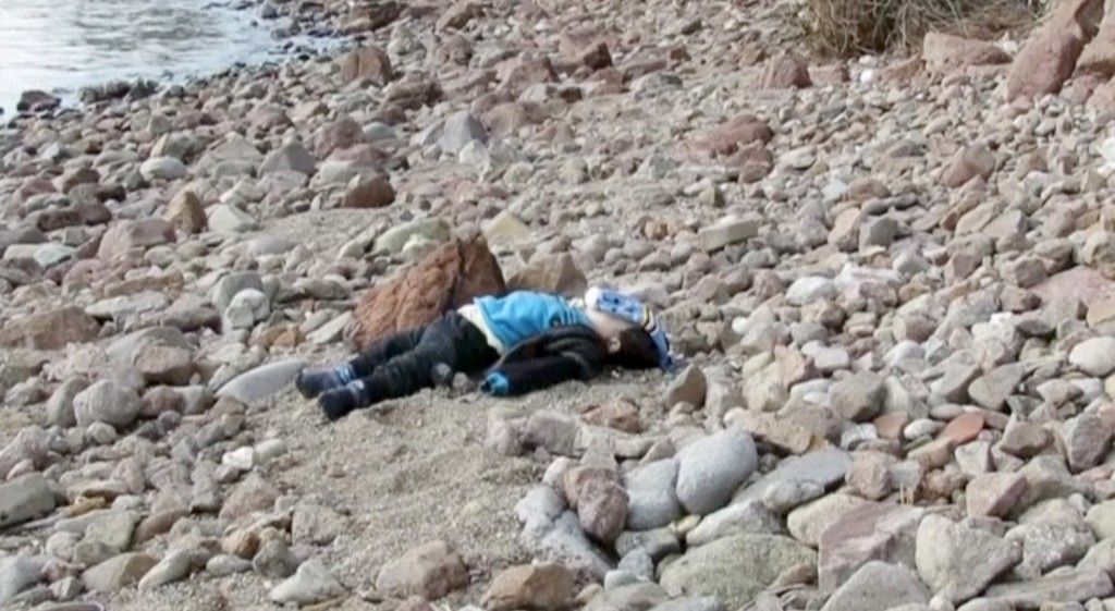 The body of a toddler washed ashore after a migrant boat sank off Turkey's western coast of Ayvacik is seen in this still image from video taken January 30, 2016. Almost 40 people drowned and 75 were rescued after a boat carrying migrants to Greece sank off Turkey's western coast on Saturday, according to local officials and the Turkish Dogan news agency. The Turkish coast guard was continuing search and rescue efforts where the 17-metre boat carrying at least 120 people sank off the coast of Ayvacik, a town across from the Greek island of Lesvos, the Dogan news agency reported.  Reuters TV/Reuters
