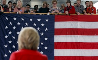 "Audience members listen as U.S. Democratic presidential candidate Hillary Clinton speaks during a ""Get Out to Caucus"" rally at Iowa State University in Ames, Iowa January 30, 2016.  REUTERS/Brian Snyder - RTX24Q39"
