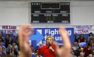 Supporters applaud U.S. Democratic presidential candidate Hillary Clinton as she speaks during a campaign rally at Washington High School in Cedar Rapids, Iowa January 30, 2016.  REUTERS/Adrees Latif    - RTX24R4V