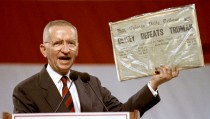 Independent Presidential candidate Ross Perot holds aloft historic newspaper Nov 1 that declared Thomas Dewey the victor in the presidential race against Harry Truman. Perot drew a parallel to his own candidacy in front of 12,000 people. - RTXF2YE
