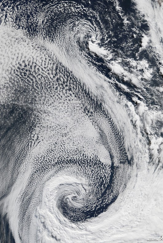 What begins with S? Swirling stratocumulus sliding over salty Atlantic seas! Stratovolcanoes, sulfates, and sunglint. Satellites andspectrometers. On April 29, 2009, the Moderate Resolution Imaging Spectroradiometer (MODIS) on the Terra satellite acquired this image of clouds swirling over the Atlantic Ocean.