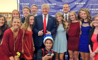 Donald Trump posing with Urbandale High School students and government teacher Anne La Pietra (on right). Photo courtesy of Anne La Pietra