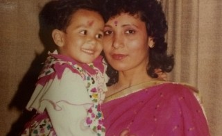 Yashica Dutt grew up in India and was afraid of what would happen if people would learn her family belonged to the lowest caste. Here, her mother, Shashi Dutt, holds her during her third or fourth birthday at their home in Ajmer in Rajasthan. Photo courtesy of Yashica Dutt
