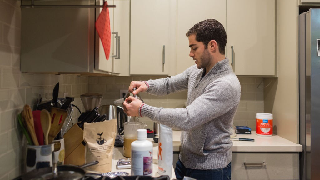 Tom‡s GutiŽrrez making his daily nootropic coffee beverage with butter, cream, and powdered coconut oil.  Photo by Jason Henry/STAT