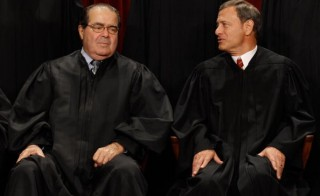 Supreme Court Associate Justice Antonin Scalia and Chief Justice John Roberts, seen in this 2010 photo from the East Conference Room at the Supreme Court. Scalia, a fiery conservative who helped shape American legal thought, died on Feb. 13. Photo by Chip Somodevilla/Getty Images