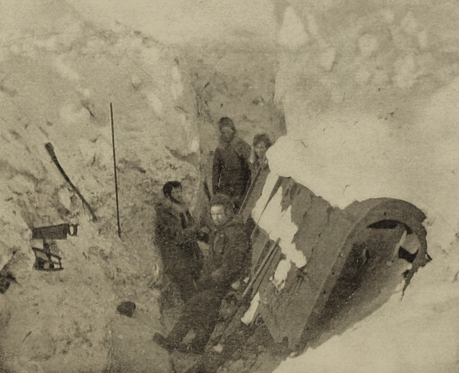 Whaling crew members trapped by Arctic ice blasting a  wreck for firewood. Photo by U.S. Library of Congress