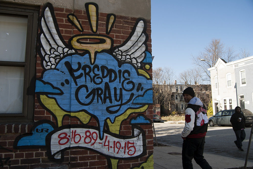 A tribute to Freddie Gray, who died after suffering an injury in police custody in April, marks the site near his arrest in West Baltimore. Photo by Iman Smith/Capital News Service