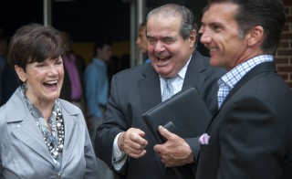 BETHESDA, MD - JUNE 4: Supreme Court Justice Antonin Scalia, center, laughs with Sharon Taskey and her son, Todd Taskey, after a short conversation about baseball loyalties after graduation at Stone Ridge School of the Sacred Heart where Scalia gave the commencement address June 04, 2015 in Bethesda, MD.   (Photo by Katherine Frey/The Washington Post via Getty Images)