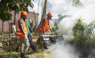 Dominican Air Force personnel fumigate various locations in Santo Domingo against the Aedes aegypti mosquito, which transmits the Zika virus. Photo by Erika Santelices/AFP/Getty Images