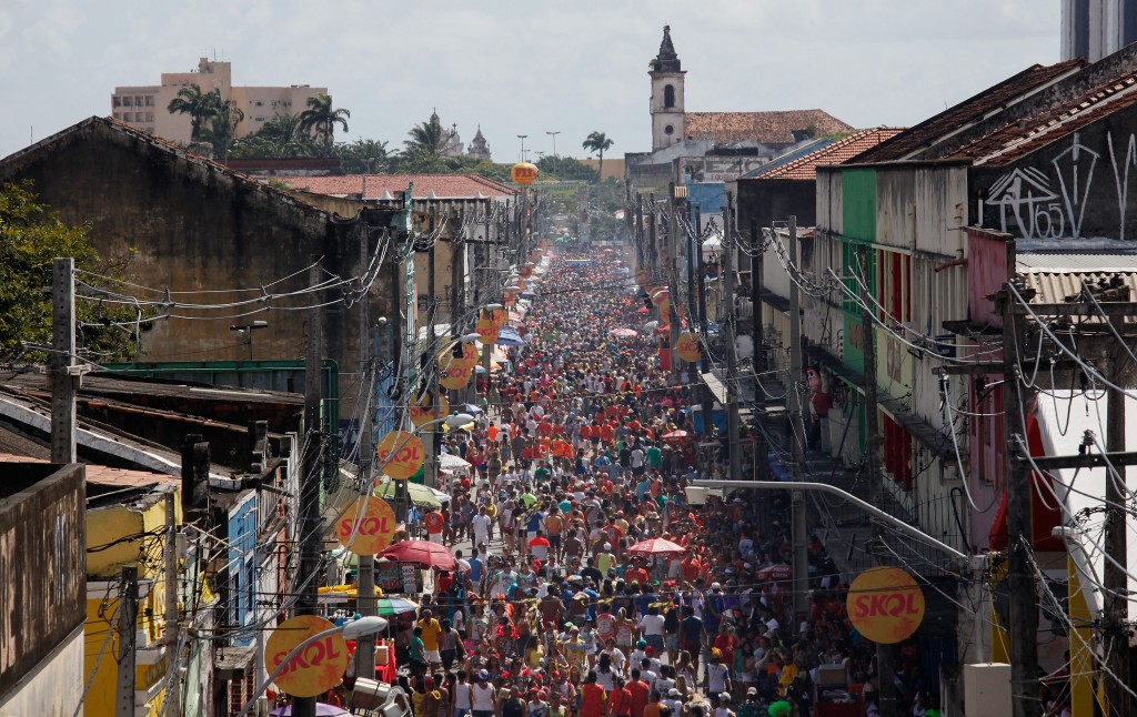 RECIFE, BRAZIL - FEBRUARY 06:  Revellers gather during the Galinho da Madrugada 'bloco', or street parade, during Carnival          celebrations on February 6, 2016 in Recife, Pernambuco state, Brazil. Officials say as many as 100,000 people may have already          been exposed to the Zika virus in Recife, which is being called the epicenter of the Zika outbreak, although most people never          develop symptoms.  (Photo by Mario Tama/Getty Images)