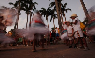 OLINDA, BRAZIL - FEBRUARY 06: Dancers are blurred in a long exposure during Carnival celebrations on February 6, 2016 in Olinda, Pernambuco state, Brazil. Revellers in Olinda and sister city Recife are gathering for various concerts and street parades during Carnival in spite of fears over the Zika virus. (Photo by Mario Tama/Getty Images)