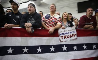 People wait for the doors to open for a Republican presidential candidate Donald Trump campaign rally at  Plymouth State University on February 7, 2016 in Holdernes, New Hampshire. Democratic and Republican Presidential are stumping for votes throughout New Hampshire leading up to the Presidential Primary on February 9th.