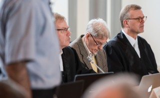Former Auschwitz guard Reinhold Hanning (2R) sits between his lawyers Andreas Scharmer (2L) and Johannes Salmen (R) as he waits for the start of his trial at court in Detmold, western Germany, on February 11, 2016.  The 94-year-old former Auschwitz guard went on trial for complicity in the murders of tens of thousands of people at the Nazi concentration camp.  / AFP / POOL / Bernd Thissen        (Photo credit should read BERND THISSEN/AFP/Getty Images)