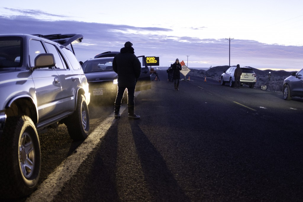 Media wait at a checkpoint about 4 miles from the Malheur Wildlife Refuge Headquarters near Burns, Oregon, on February 11, 2016.   The FBI surrounded the last protesters holed up at a federal wildlife refuge in Oregon amid reports they will surrender on Thursday, suggesting the weeks-long armed siege is approaching a climax. / AFP / Rob Kerr        (Photo credit should read ROB KERR/AFP/Getty Images)