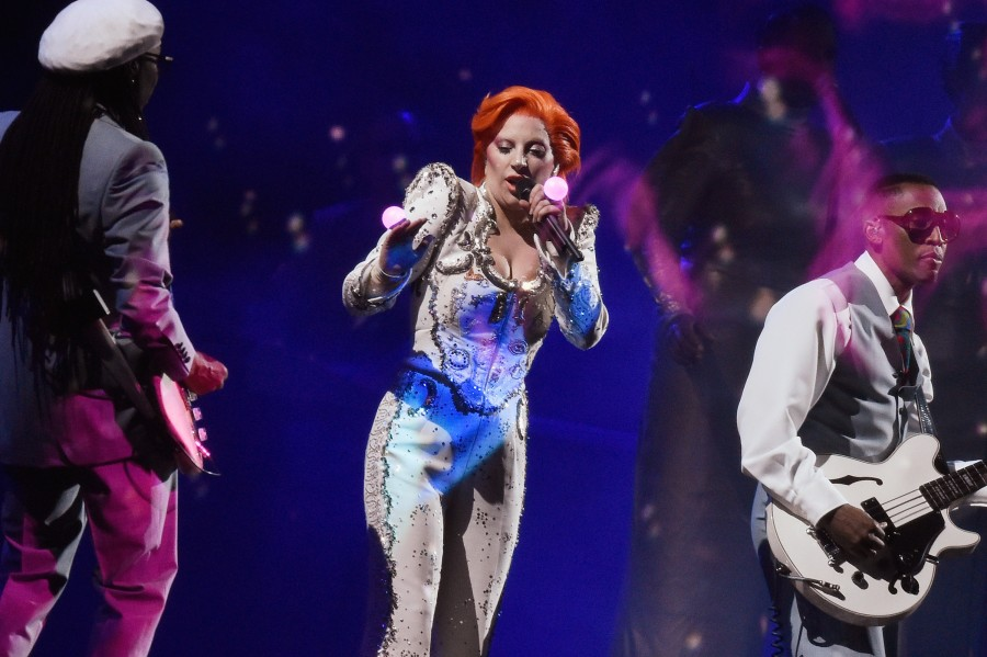 LOS ANGELES, CA - FEBRUARY 15:  Singer Lady Gaga (C), accompanied by musician/producer Nile Rodgers (L), performs a tribute to the late David Bowie onstage during The 58th GRAMMY Awards at Staples Center on February 15, 2016 in Los Angeles, California.  (Photo by Kevork Djansezian/Getty Images for NARAS)