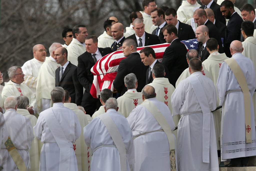 WASHINGTON, DC - FEBRUARY 20:  U.S. Supreme Court Police pallbearers carry Associate Justice Antonin Scalia's flag-covered casket between rows of Catholic clergy and out of the Basilica of the National Shrine of the Immaculate Conception following his funeral February 20, 2016 in Washington, DC. Scalia, who died February 13 while on a hunting trip in Texas, layed in repose in the Great Hall of the Supreme Court on Friday and his funeral service will be at the basillica today.  (Photo by Chip Somodevilla/Getty Images)