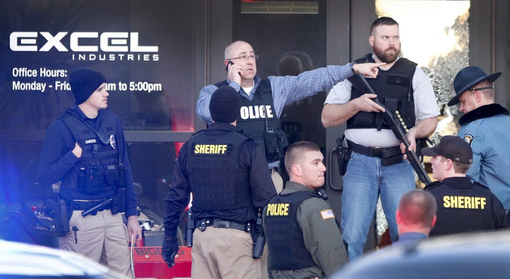Police guard the front door of Excel Industries in Hesston, Kansas, where a gunman Cedric Ford killed four people and injured 14 others Thursday afternoon. Photo by Fernando Salazar/Wichita Eagle/TNS via Getty Images